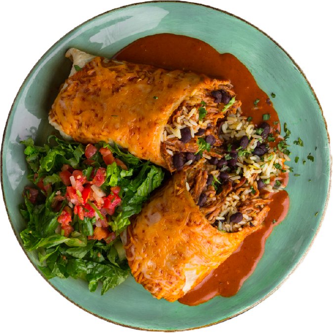 Burrito on green plate with read sauce