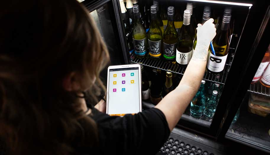 restaurant employee checking inventory of wine